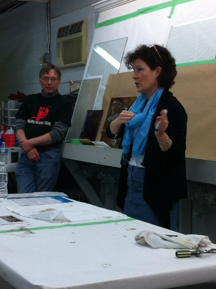 Holly sharing Alaska Cruise details at Gary Lord's Prismatic Painting Studio. Gary on the left.